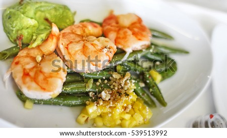 Grilled Shrimp entree with Roasted String Green Beans and Avocado Corn salsa
