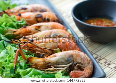 Grilled shrimp with sauce.