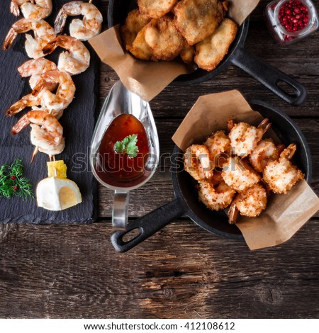 Grilled shrimps on frying pan - stock photo