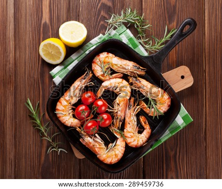 Grilled shrimps on frying pan. Top view  - stock photo