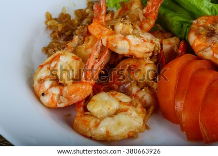 Grilled shrimps with garlic and herbs - stock photo