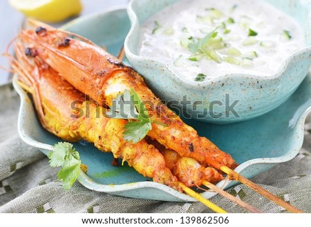 grilled shrimps  with indian sause - stock photo