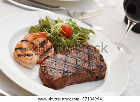 Grilled sirloin steak - Surf and turf - stock photo