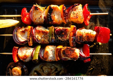 Grilled skewers of salmon and vegetables - stock photo