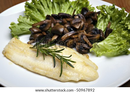 Grilled sole fish with mushrooms and herb - stock photo