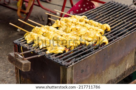 Grilled squid on skewer barbecue seafood. - stock photo