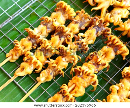 Grilled squid on the market,Thailand market - stock photo
