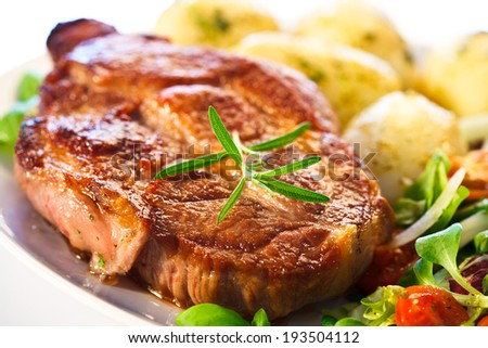 Grilled steak, boiled potatoes and vegetables