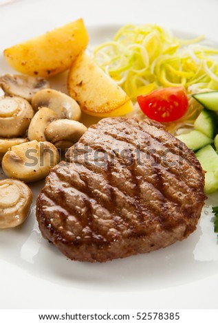 Grilled steak, chips and vegetables - stock photo