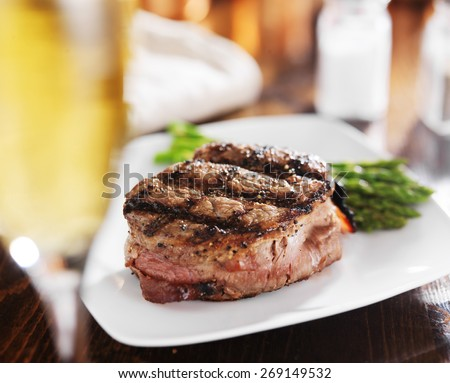 grilled steak filet with white wine and asparagus - stock photo
