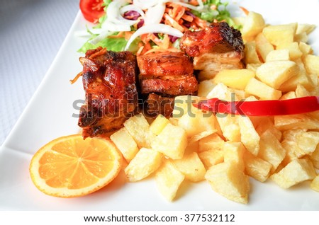 Grilled steak - Grilled meat ribs on the plate with hot sauce  - stock photo