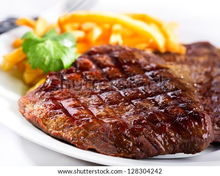 grilled steak with french fries - stock photo