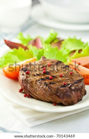 Grilled steak with fresh vegetables - stock photo