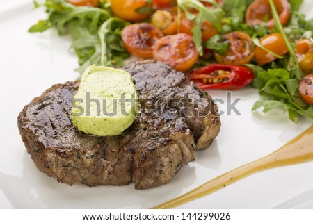 grilled steak with herb butter - stock photo