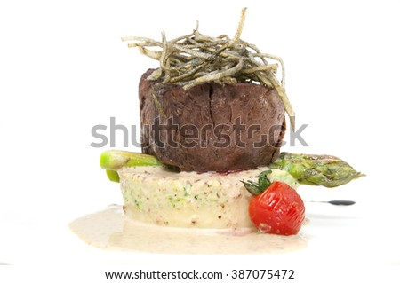Grilled steak with sauce and greens on white background - stock photo