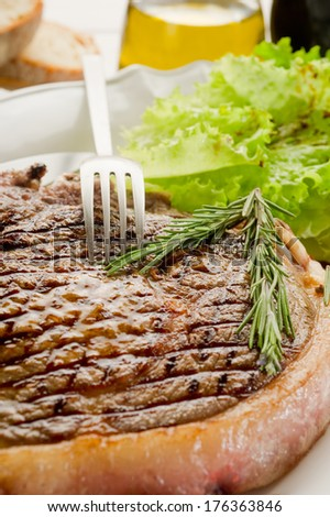 grilled t.bone on dish - stock photo