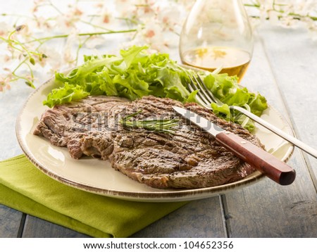 grilled t-bone with green salad - stock photo