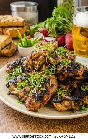 teriyaki chicken wings with chive and microgreens on top, garlic toast ...