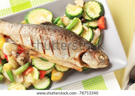 Grilled trout served with mixed vegetables - stock photo
