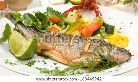Grilled trout w lime and vegetable - stock photo