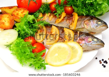 grilled trout with potatoes and fresh vegetables  - stock photo