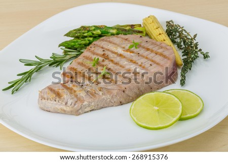 Grilled Tuna steak with asparagus and roseary - stock photo