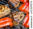 Grilled tuna steaks and cut red bell pepper on grill - stock photo