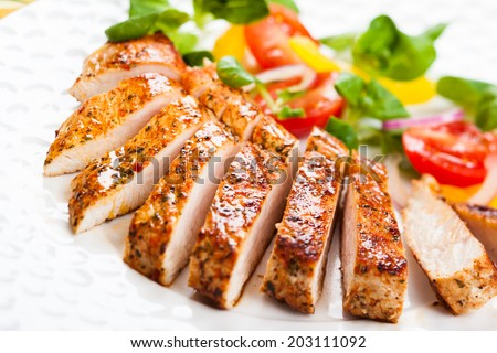 Grilled Turkey Breast with salad - stock photo