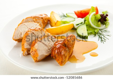 Grilled turkey fillet with vegetables - stock photo
