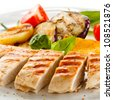 Grilled turkey fillet with vegetables on white background - stock photo