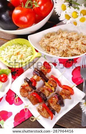 grilled turkey meat, red pepper and eggplant skewers with teriyaki sauce for lunch  - stock photo
