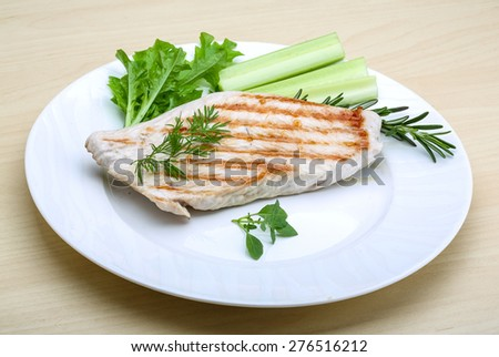 Grilled turkey steak with herbs and spices