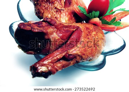 grilled turkey wings on white with salad and tomatoes - stock photo