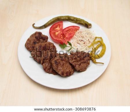 Grilled Turkish meatball ( Kofte ) - stock photo