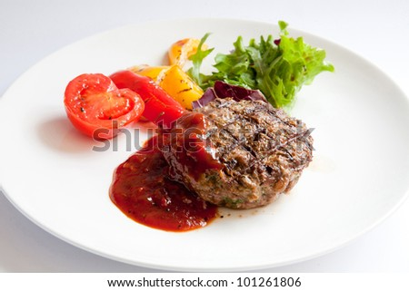 Grilled Veal Chop with vegetables and barbecue sauce;