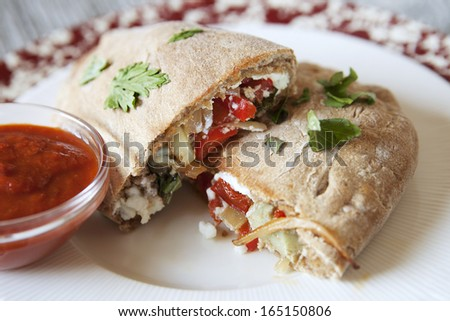 Grilled Vegetable Calzone Cal-Zone stuffed with cheese and peppers - stock photo