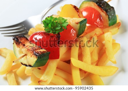 Grilled vegetable skewer with French fries