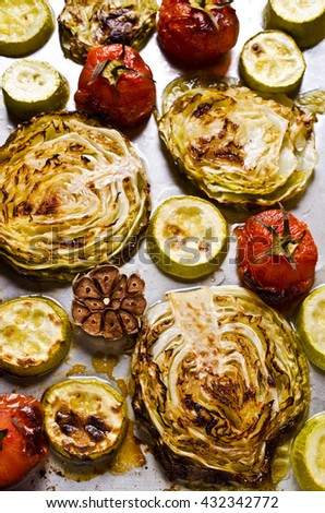 Grilled vegetable slices on a metal background. Selective focus.