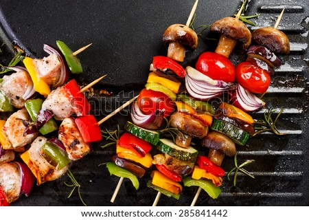 Grilled vegetables and fish skewers - stock photo