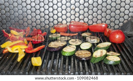 Grilled vegetables are cooking with fire