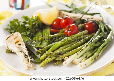 grilled vegetables - asparagus, onions, peas, tomatoes - stock photo