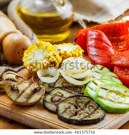 Grilled vegetables meal on a table. Tomato, corn, eggplant, mushroom, bell pepper, marrow and onion prepared on a barbecue. Healthy food.