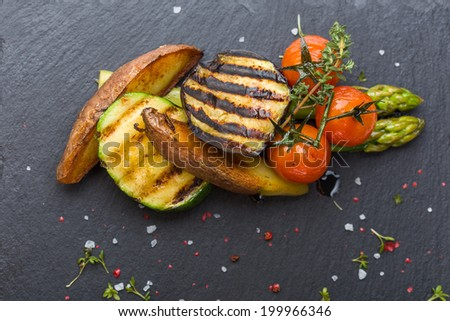 Grilled vegetables on black background - stock photo