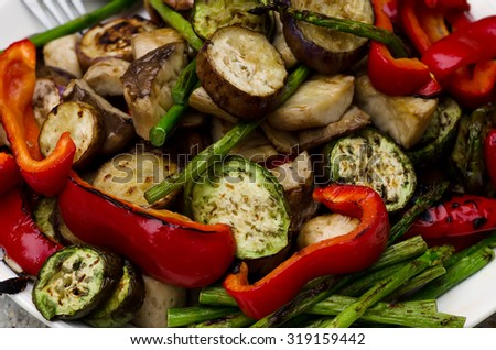 Grilled Vegetables on white plate. Closeup photo.