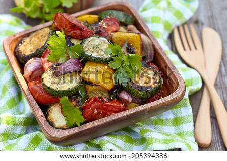 Grilled vegetables salad with zucchini, eggplant, onions, peppers and tomato - stock photo