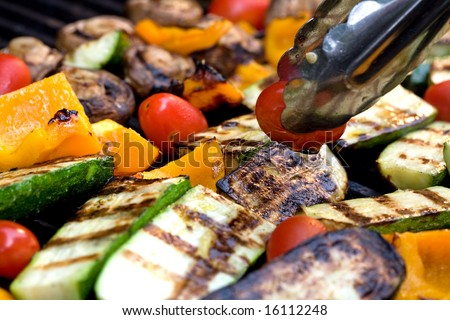 Grilled Vegetables. Zucchini, tomato, pepper, and mushroom barbecue.