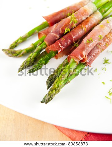 Grilled Young Asparagus Wrapped in Prosciutto Meat - stock photo