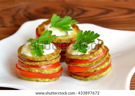 Grilled zucchini with chopped fresh tomatoes, yoghurt and green parsley. Squash vegetarian recipes. Easy summer appetizer. Simple snacking for summer. Delicious vegetable food. Closeup - stock photo