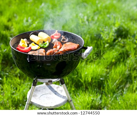 Grilling at summer weekend. Fresh meat and vegetables preparing on grill. - stock photo