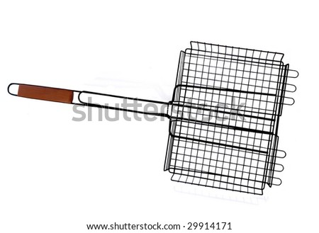 GRILLING BASKET FOR FISH,VEGETABLE OR SMALL FOOD ITEMS - stock photo
